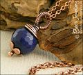 Deep blue faceted jade and copper pendant on chain