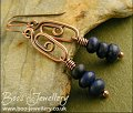 Long copper spiral link earrings with Lapis rondelle stack