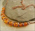 Faux amber and copper necklace with mobius ring separators - made to order
