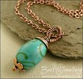 Turquoise glass and copper wire wrapped pendant on chain