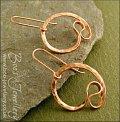 Polished copper hammered swirl loop earrings