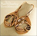 Teardrop shaped earrings featuring scrolls and leaves - RESERVED