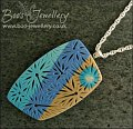 Polymer clay blue tones carved pendant on rope chain