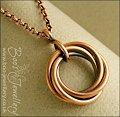 Antiqued copper mobius flower pendant on belcher chain